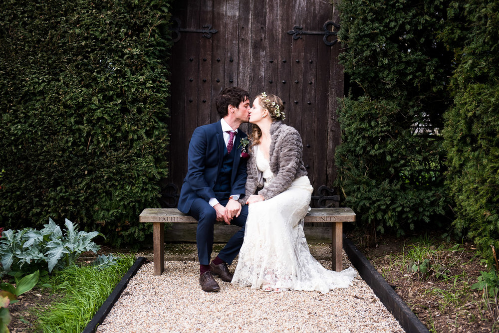 Couple kissing in the gardens of Gaynes Park, Essex