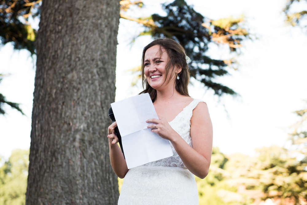 Beautiful Maggie Sottero bride giving an emotional speech at her wedding Bride and groom embrace in the beautiful grounds at Camberley Heath Golf Club, Surrey © Jessica Grace Photography