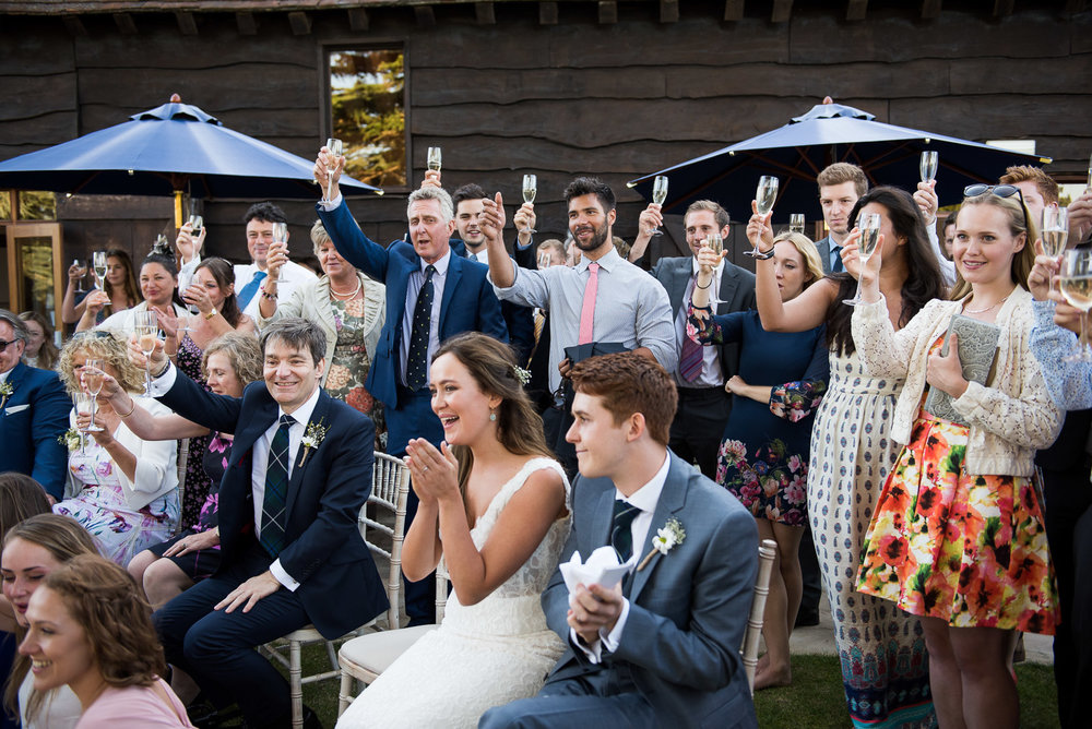 Champagne toast at elegant summer  wedding. Surrey Wedding Photographer © Jessica Grace Photography