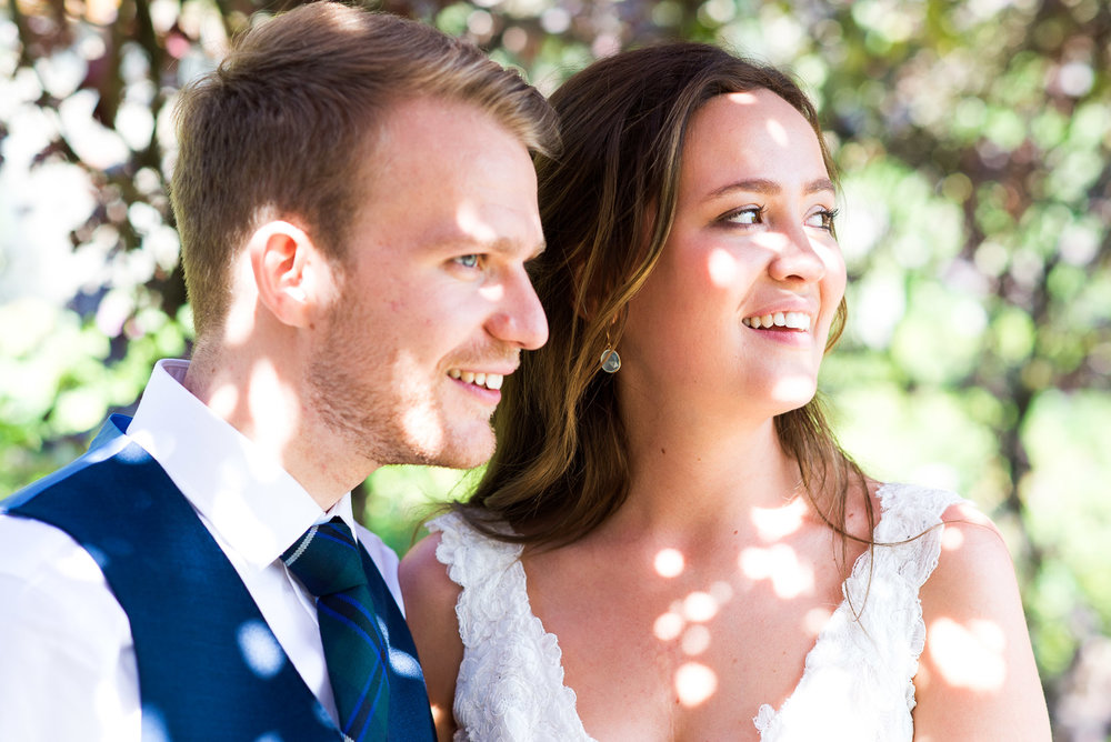 Dappled sunlight in the gorgeous gardens at Loseley Park Bride and groom embrace in the beautiful grounds at Camberley Heath Golf Club, Surrey © Jessica Grace Photography
