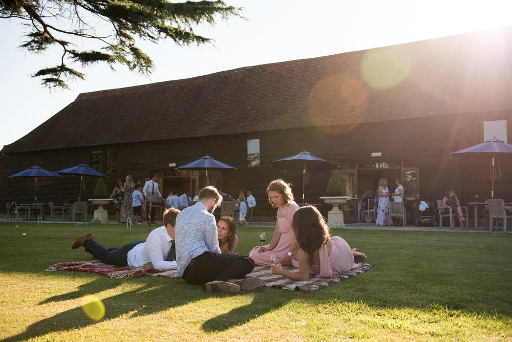 Evening light at summer wedding in Loseley Park, Surrey Bride and groom embrace in the beautiful grounds at Camberley Heath Golf Club, Surrey © Jessica Grace Photography