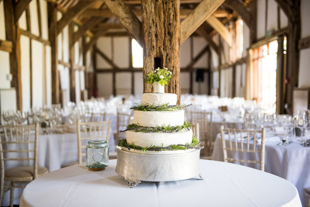 Hand made cake by the grooms mother for a relaxed summer wedding at Loseley Park © Jessica Grace Photography