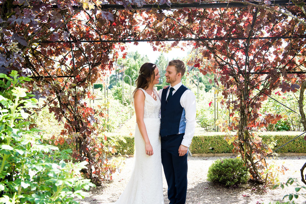 Maggie Sottoero bride with her groom in natural couples portraits Bride and groom embrace in the beautiful grounds at Camberley Heath Golf Club, Surrey © Jessica Grace Photography