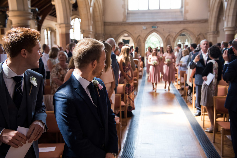 Natural wedding photography, the bridal party entering the church © Jessica Grace Photography
