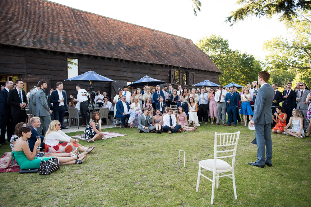 Outdoor speeches by the barn at Loseley Park Bride and groom embrace in the beautiful grounds at Camberley Heath Golf Club, Surrey © Jessica Grace Photography