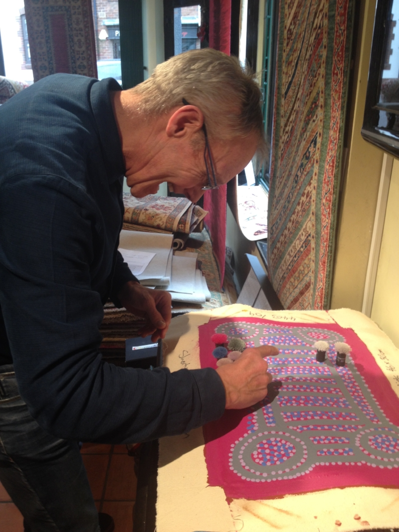 The Rug Makers: dedicated to their craft! Here they painstakingly colour match the artist's palette...