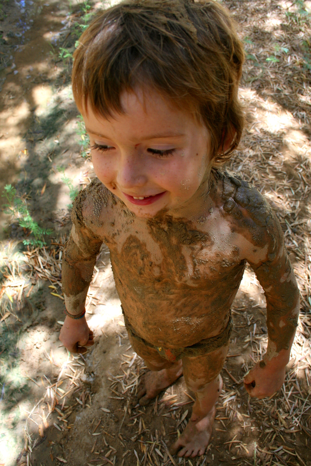Luca covered in mud