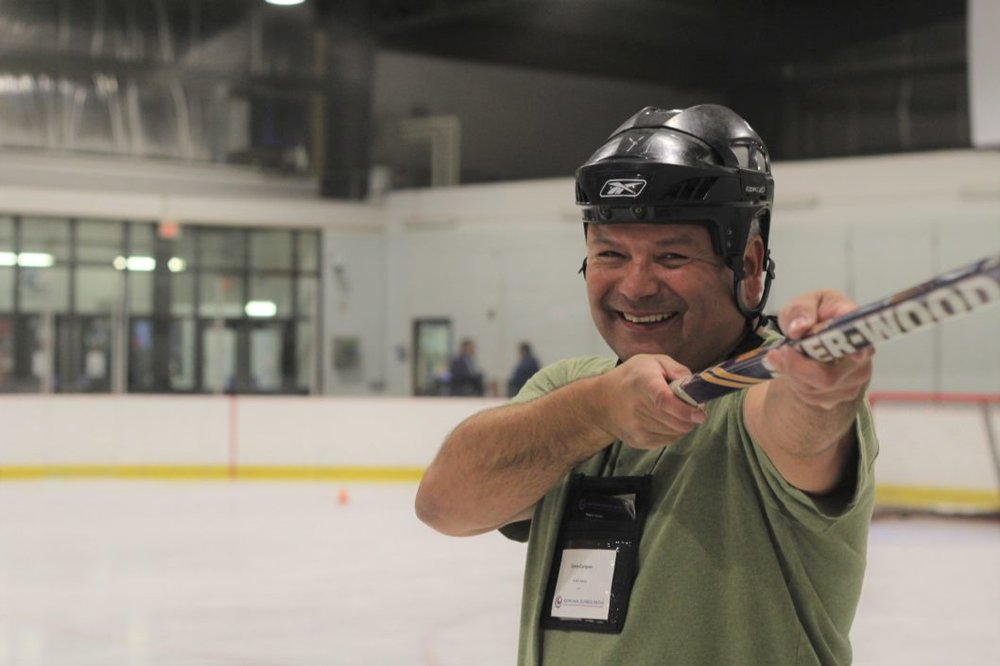 Denis Carignan, President of PLATO Testing, wins the ABM Hockey Challenge at ABM Alberta.