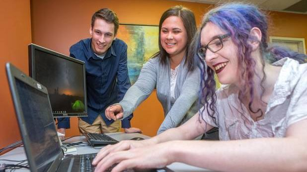From left: Devin Brooks, Shawnee Polchis-Lanteigne and Indigo Poirier work on a project at the offices of PQA Testing in Fredericton, NB. (James West/The Globe and Mail)