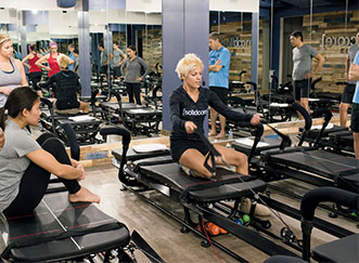 Solidcore founder Anne Mahlum demonstrating how to use the Sweatlana.  [Photo originally appeared in the  Washingtonian .]