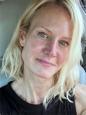 A makeup-free, post-HydraFacial selfie taken in the parking lot.