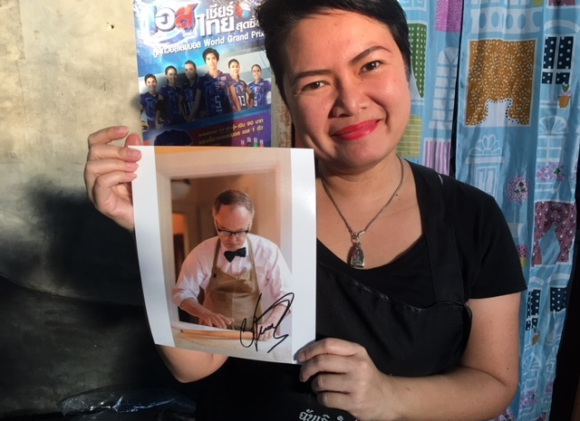This shot was taken at the Hot Basil Restaurant for People who like to Eat Spicy Food! Anthony Bourdain had beaten Chris there, but they wanted a signed photograph with a cook who wears a bow tie. (Chris didn't see any bow ties in Chiang Mai!)