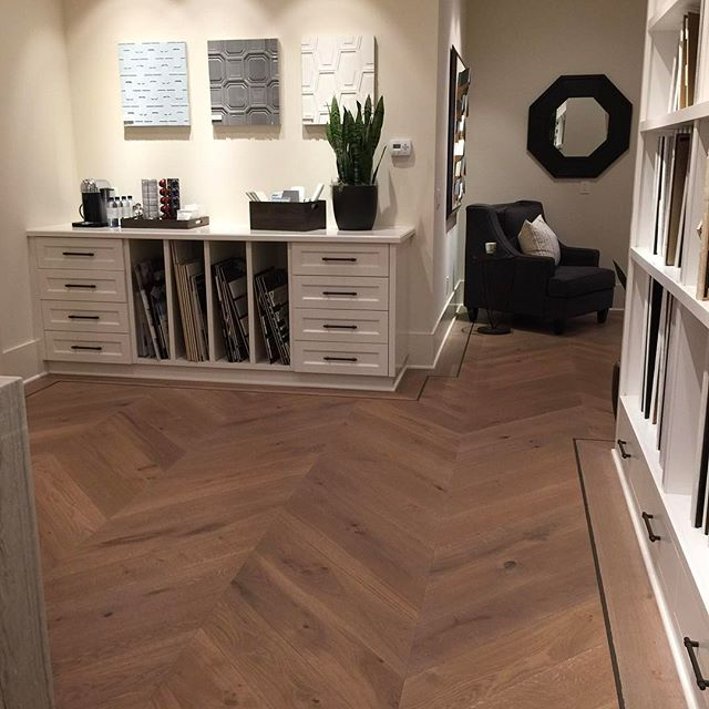 Talk about a design studio! This custom wide plank Chevron is framed throughout the space with a Metal Inlay. | details details details |  #warrenchristopher #warrenchristopheroc #warrenchristophercollection #woodfloor #woodfloors #woodflooring #customwood #customwoodflooring #eurooak #frenchoak #wideplank #wideplankfloors #ihavethisthingwithfloors #crystalcove #design #designstudio #thenewhomecompany #coralcrest #chevron