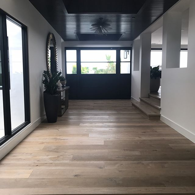 "Monday Vibes. This recently completed #cameohighlands project is officially off the market! How amazing is everything about this house? 🙌🏻 Builder: Nicholson Construction  Design: Nicholson Construction [Julie Peterson] Spec: 9"" Euro Oak. Wire Brushed, and Hand Scraped, Matte Urethane Finish.  #warrenchristopher #warrenchristopheroc #warrenchristophercollection #woodfloor #woodfloors #woodflooring #customwood #customwoodflooring #eurooak #frenchoak #wideplank #wideplankfloors #ihavethisthingwithfloors #nicholsonconstruction #cameohighlands"