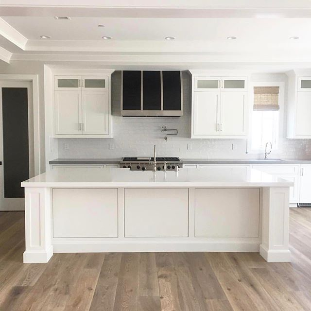 Repost of this AMAZING kitchen! |insert drooling emoji here|  Spec: Deep Fumed Euro Oak, Custom Color (aka Hermosa Beach Option 1)  Builder: @grissingerfinehomes @jeremygrissinger  Designer: @brookewagnerdesign  A before 📷 from our install last week, sleek & clean and ready for furniture👌🏼#bwd #whitekitchen #interiordesign #lightandbright #contrastingcountertops #pentalquartz #interiors #grissingerfinehomes 🔨@jeremygrissinger