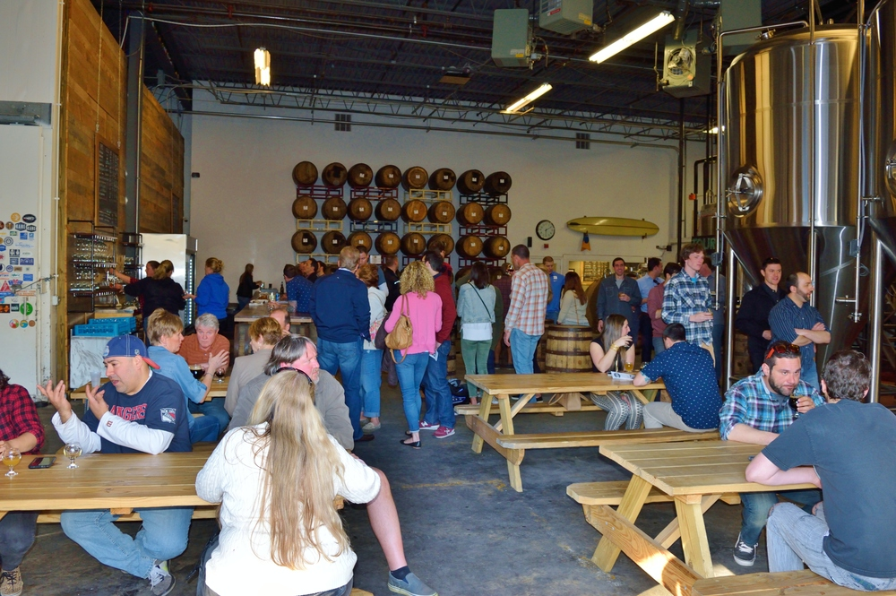 The outside taproom: benches and barrels galore!