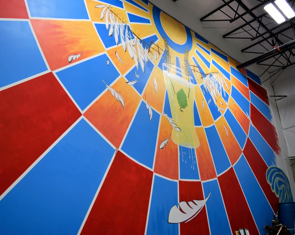 "Beautiful mural welcomes you to the ""outer"" taproom at Icarus Brewing."