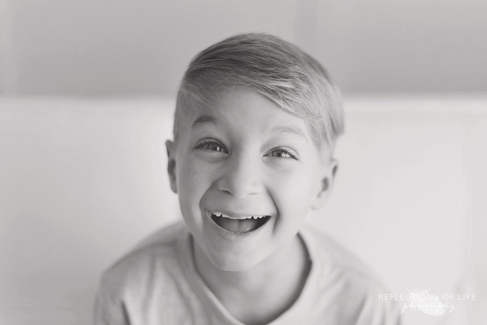 Little Boy Laughing in Black and White