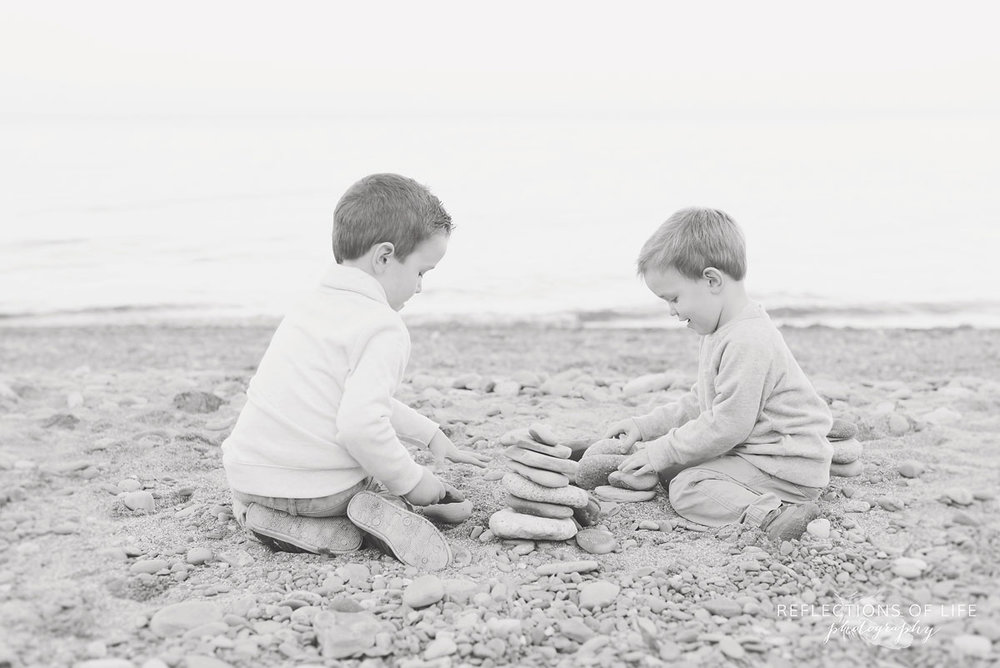 siblings on the beach in southern ontario canada
