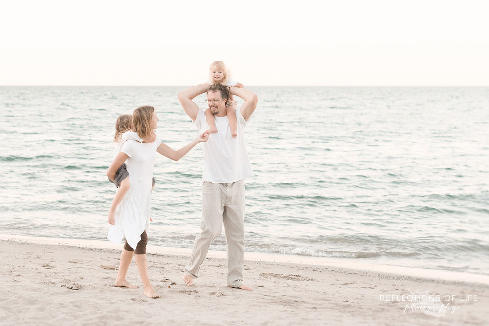 Grimsby Ontario casual family photos on the beach laughing together
