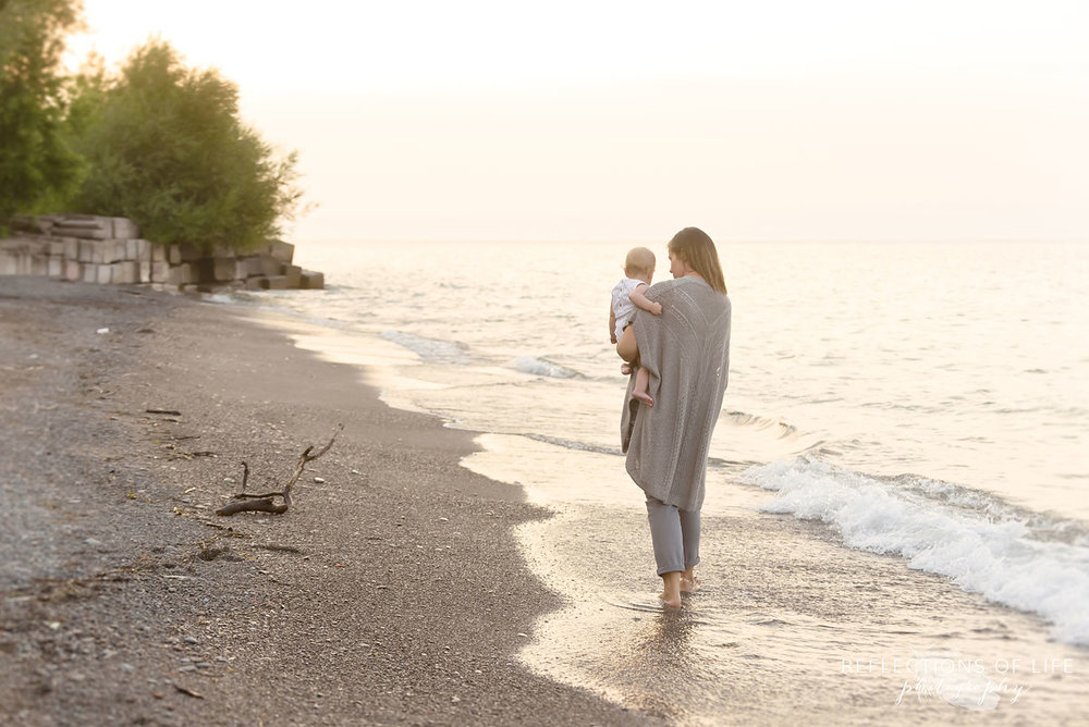 008 Mother daughter walking on the beach together in Niagara Ontario Canada
