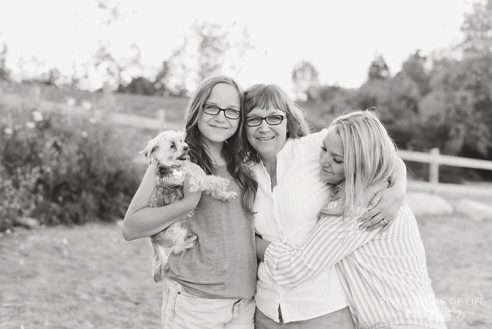 Lifestyle family photography of mother and daughters hugging in Grimsby Ontario Canada.jpg