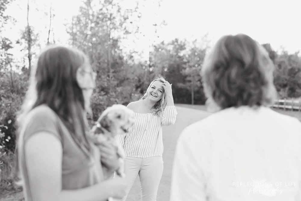 Candid family photography of mom and daughters and dog in Niagara Ontario Canada.jpg