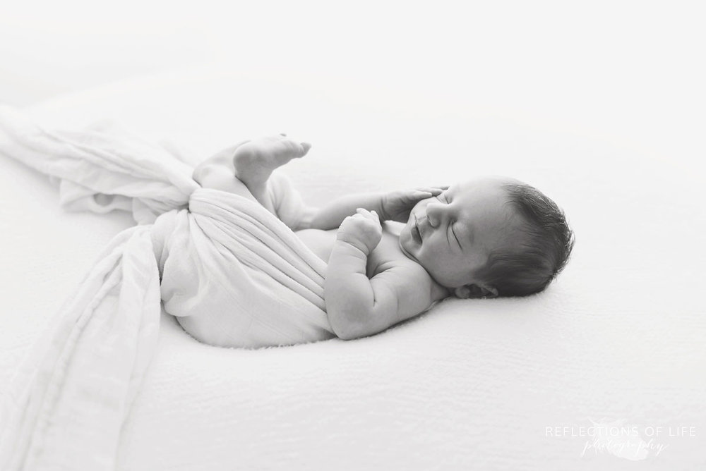 Newborn baby boy sleeping on beanbag in Grimsby Ontario photo studio