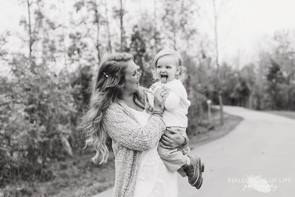 black and white of mother and toddler boy laughing.jpg