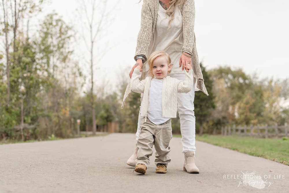 mother and son photography walking down a pathway in Grimsby Ontario Canada.jpg