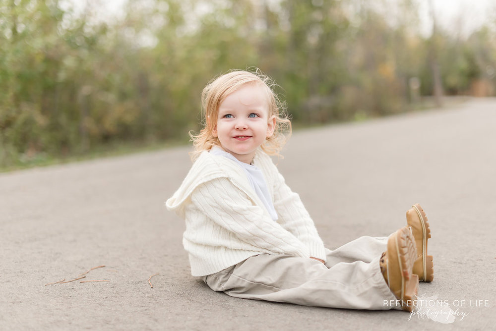 Professional Niagara Family Photography of little boy sitting on pathway in Grimsby Ontario.jpg