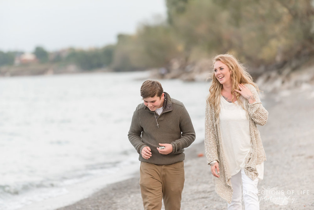 Mother and son laughing as they walk down the beach.jpg