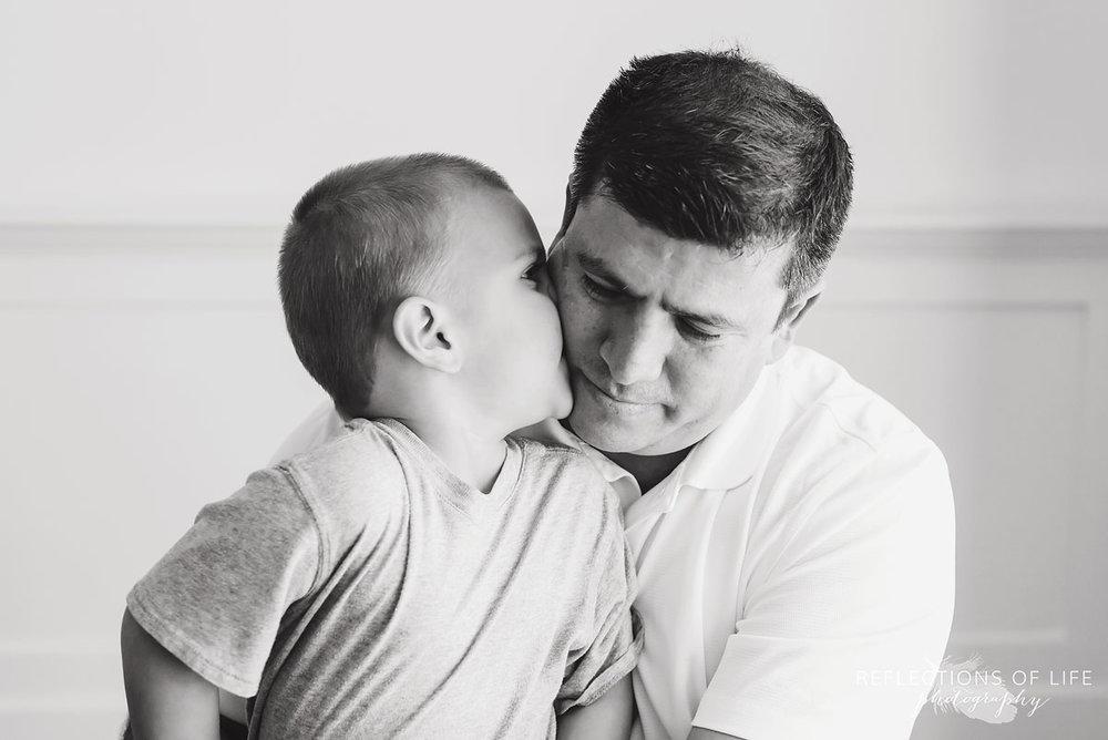 Big borther Jonathan giving his daddy kisses