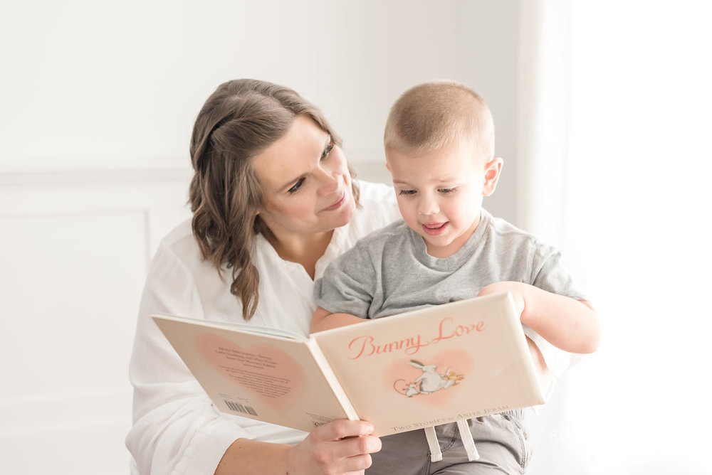 Mother and son reading a book together