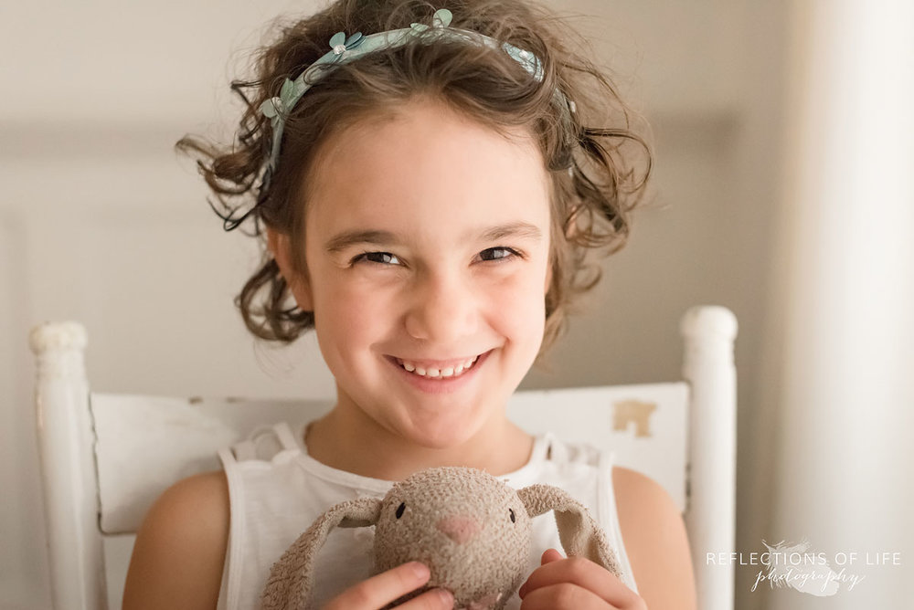 young girl smiling holding bunny