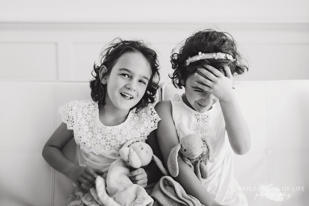 twins holding bunnys black and white