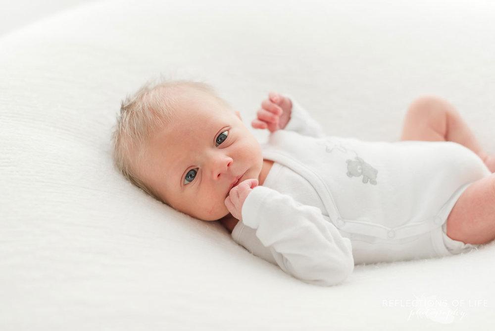 wide eyed newborn baby