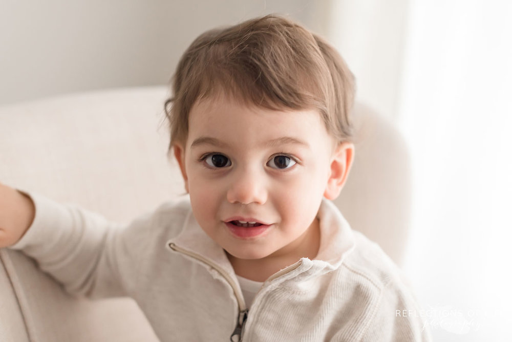 Adorable young boy in natural light studio