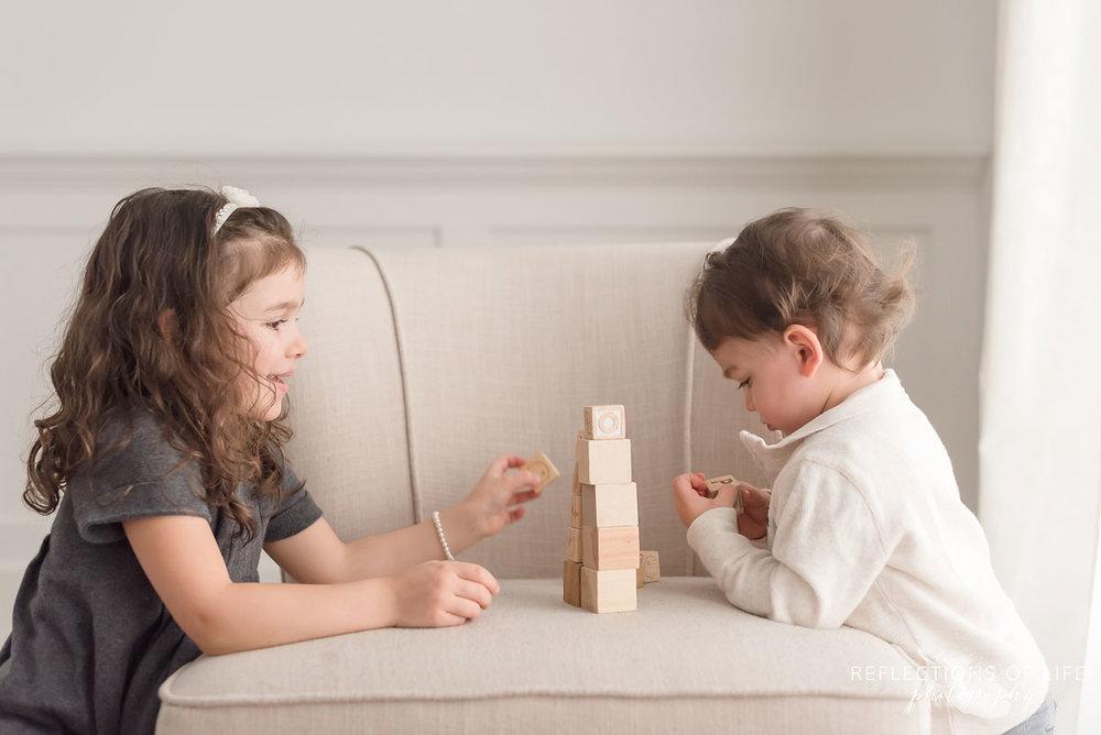 Siblings playing blocks in natural light studio Grimsby Ontario