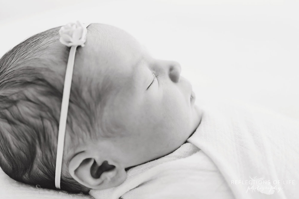 side profile of newborn baby girl in natural light photo studio grimsby ontario