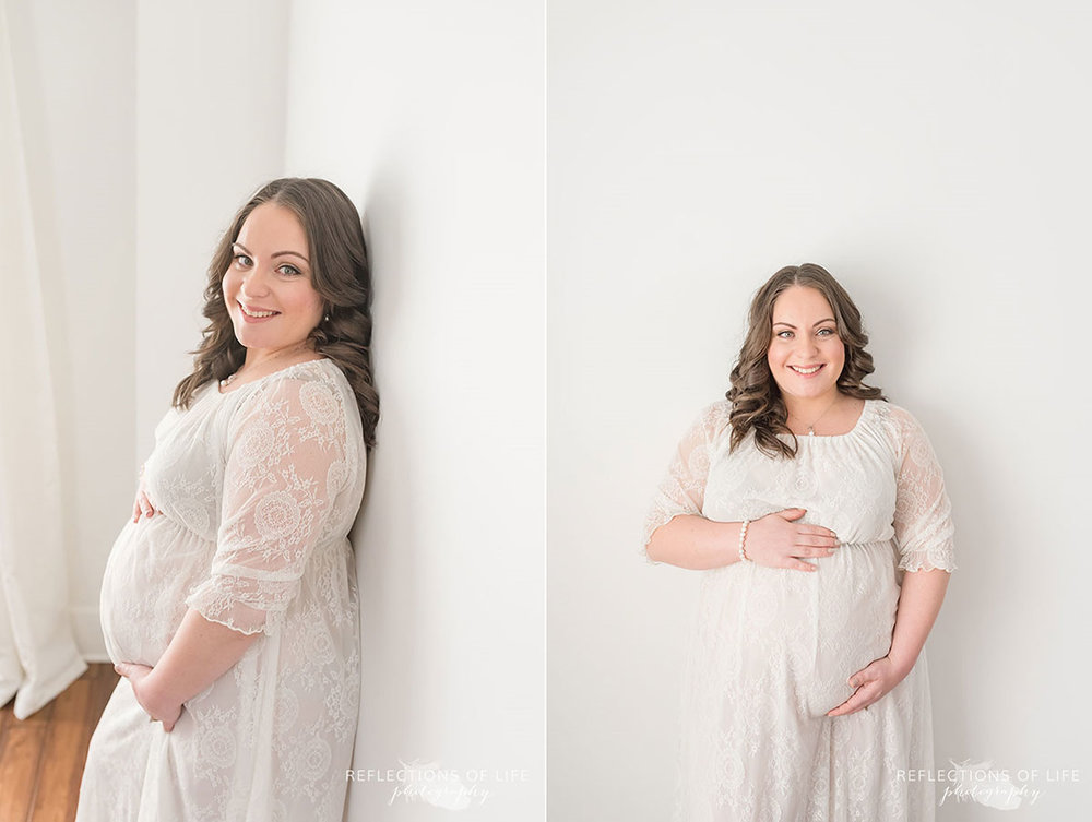 Pregnant mama holding her belly in white walled studio