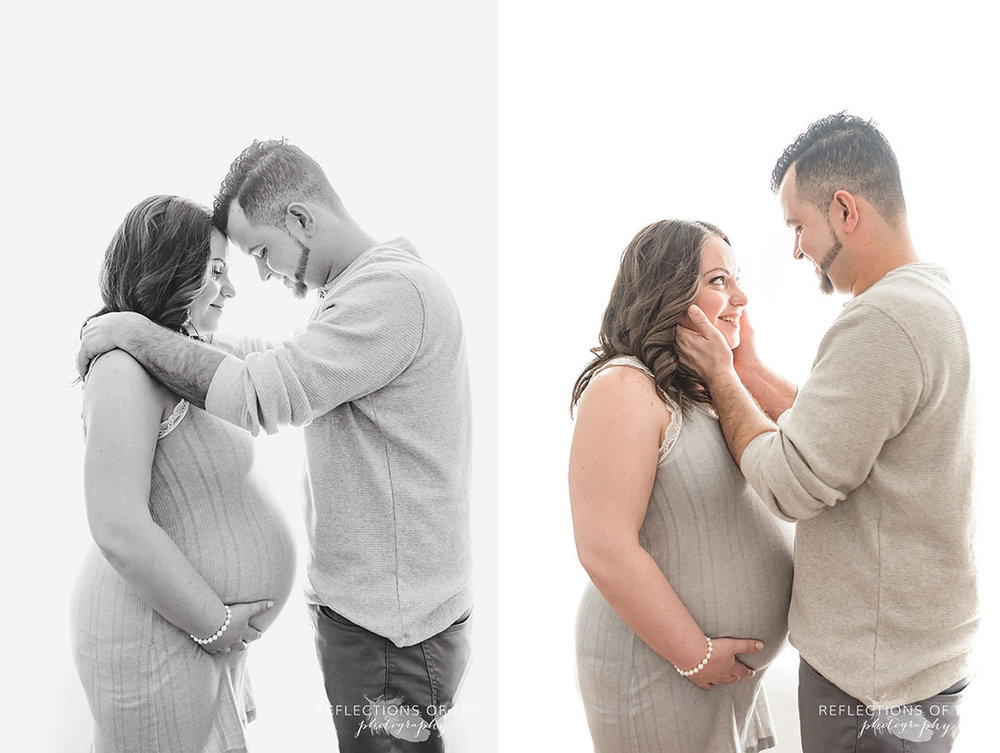Gorgeous pregnant mom and her loving husband backlit in natural light studio