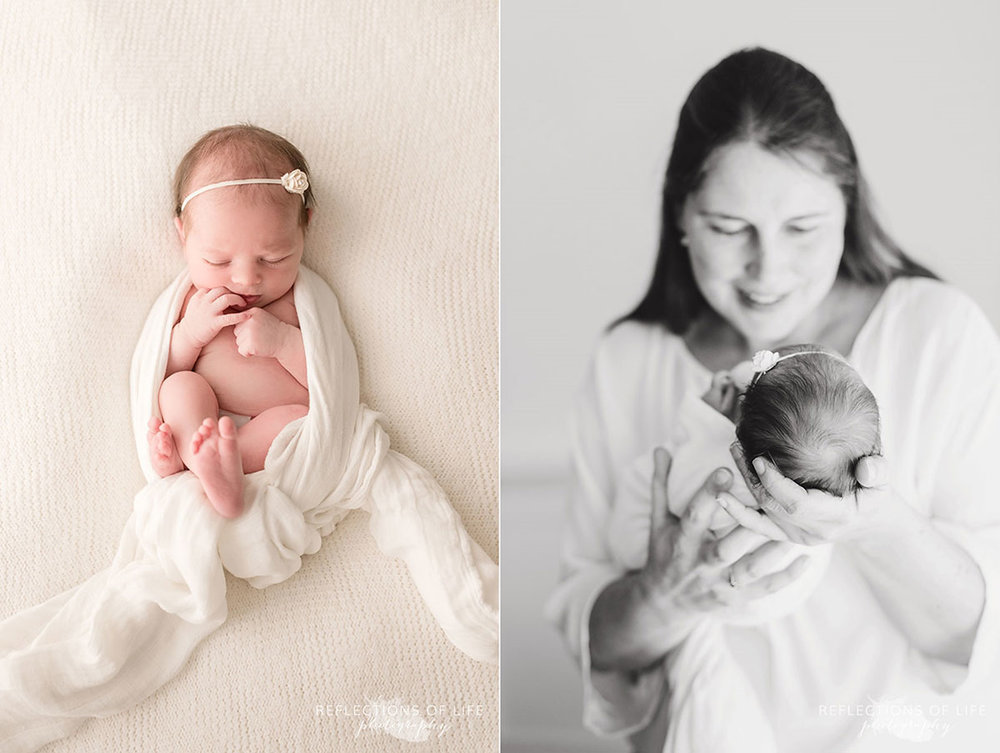 newborn baby girl wrapped in white and in mother's arms
