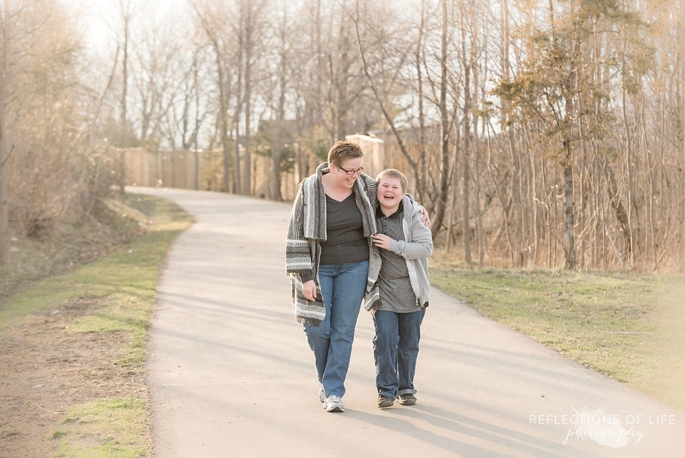 mother and son walking down a path in Grimsby Ontario Canada