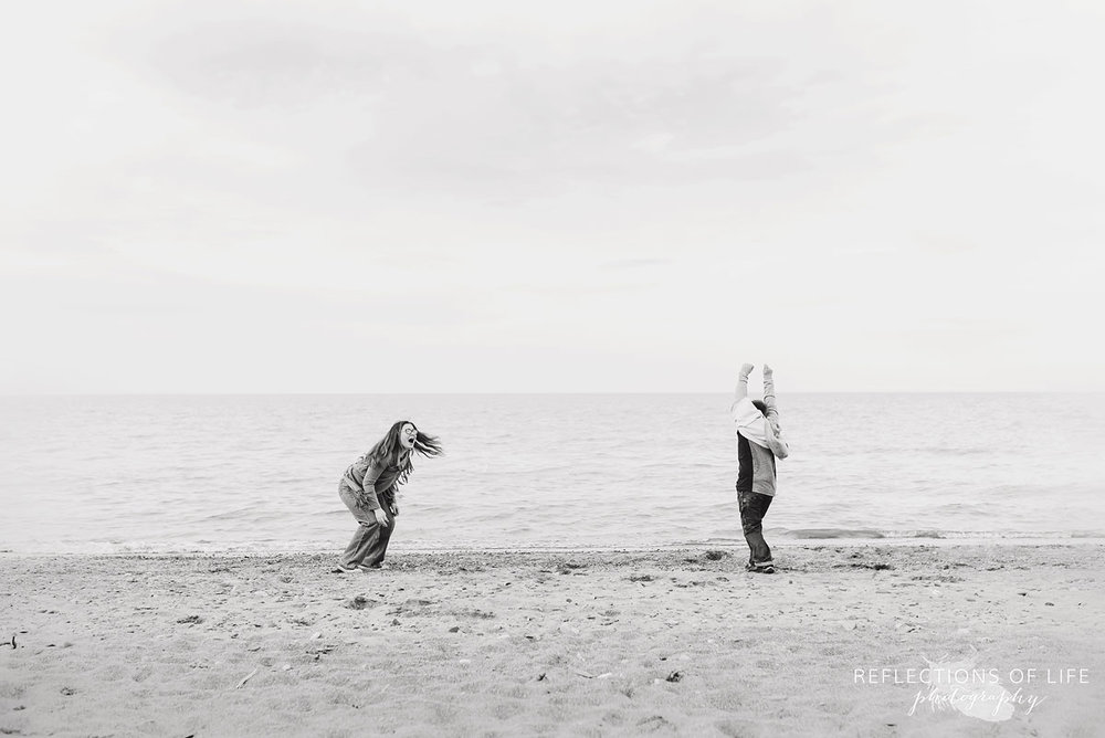 lifestyle family photos by the beach in Grimsby Ontario