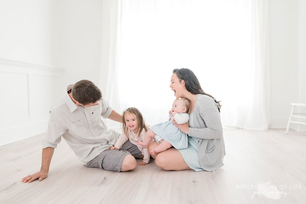Candid family photoshoot on floor in Grimsby Ontario