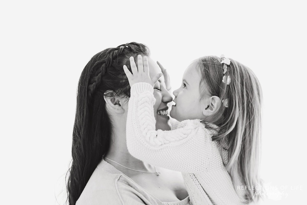 Black and white of mother and daughter smiling