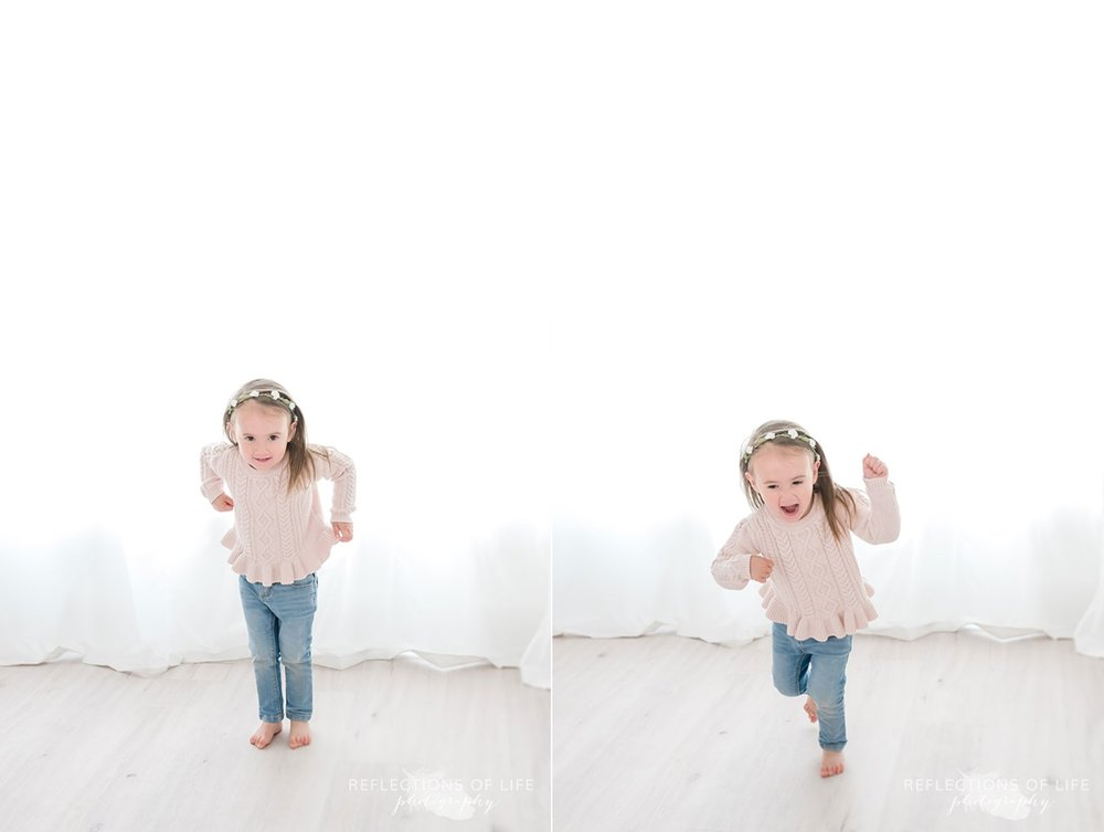Young girl with flower head band on running around studio