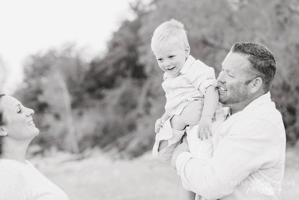 Candid family photography by the lake in Niagara Ontario