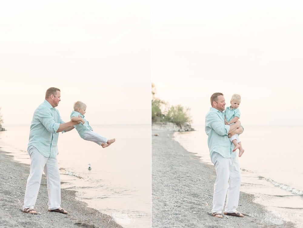 Dad holding his son by beach in Niagara Ontario